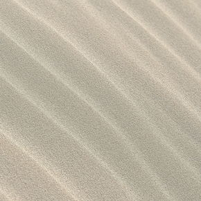 A close-up of sand, which is used for the production of Silica, a own-production of Caldic.